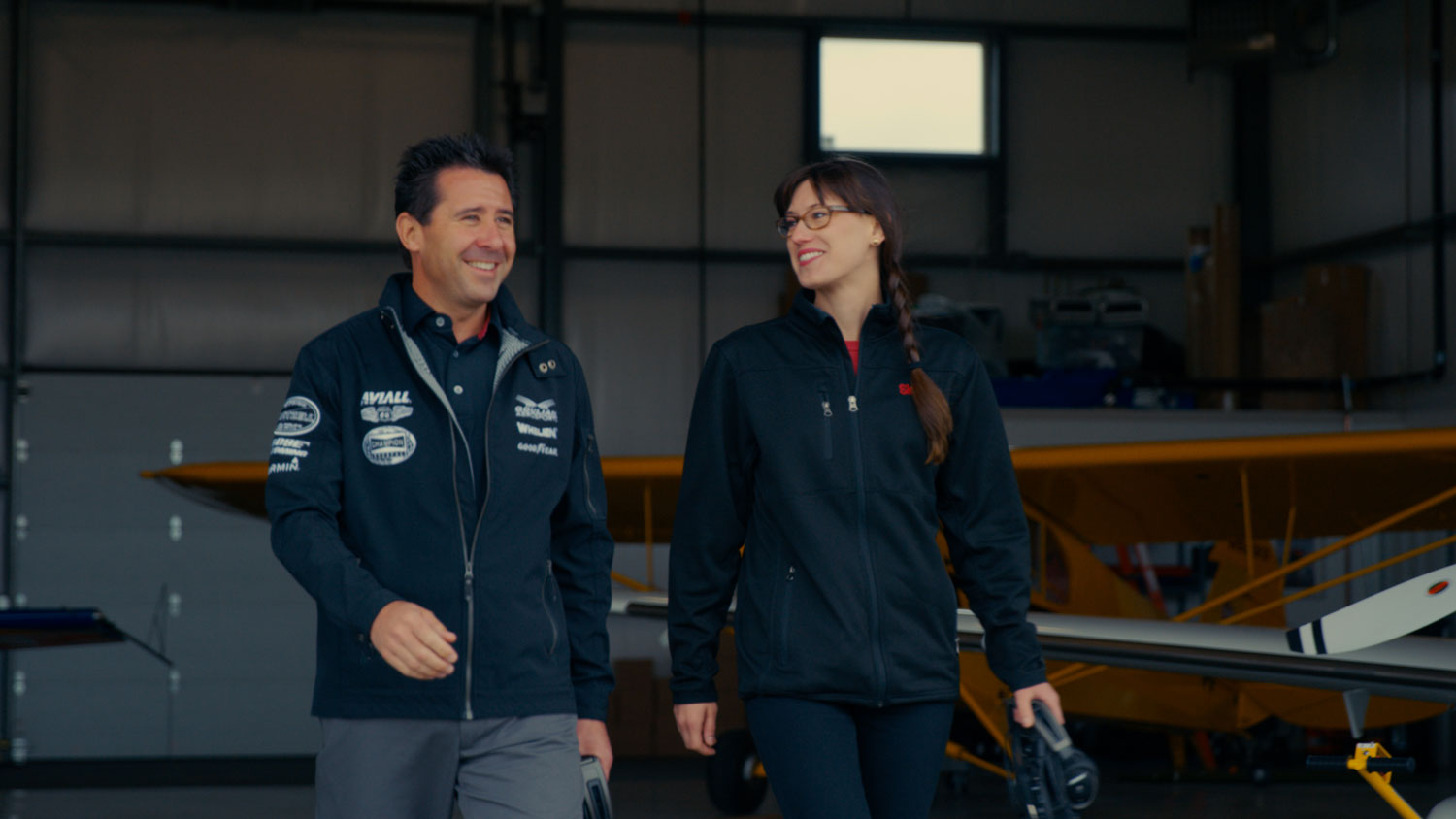 Britt and Mike Goulian walk to airplane