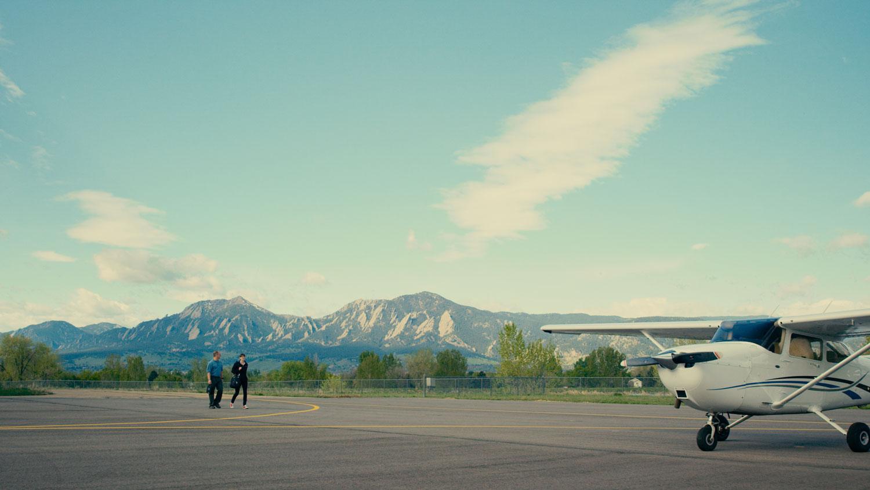 Britt walks to airplane